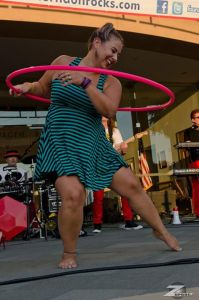 Hoopdancing to The Reflex at Friday Night Live in downtown Herndon in August 2015. Photo by Gary Corpuz.